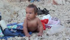 Sunburnt toddler at the beach Stock Footage