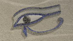 Eye of horus appears from sand carried on the wind Stock Footage