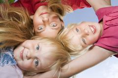 three sisters, 5 years, 13 and 7 years old - stock photo