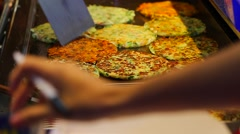 Ruifeng night market - close-up of Taiwanese egg pancake Stock Footage