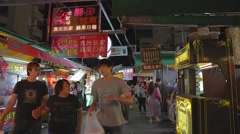 Ruifeng night market - people shopping in the market Stock Footage