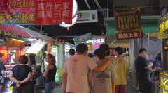 Ruifeng night market - people walking away from camera Stock Footage