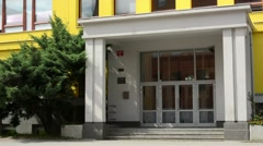 Main entrance to modern building (school):exterior - nobody - with tree Stock Footage