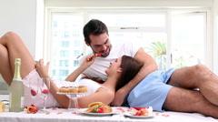 Attractive couple having an indulgent breakfast Stock Footage