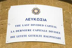 sign, the last divided capital, nicosia, cyprus, greek part, member of the eu - stock photo