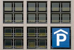 frontage of a parking block in the city centre of berlin mitte, germany, euro - stock photo