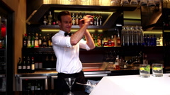 Attractive bar man making a cocktail Stock Footage