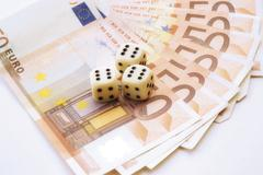 dice on fan of euro-bills - stock photo