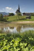 solitary farmyard and chapel of st nikolaus near inzell, municipality of trau - stock photo