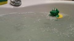 Plastic crocodile in bathtub Stock Footage