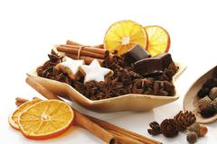 Star-shaped platter with star anise, cinnammon sticks, dried organge slices,  Stock Photos