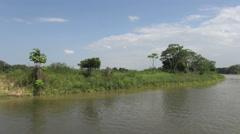 Brazil Amazon backwater near  Santarem backwater bank some trees s Stock Footage
