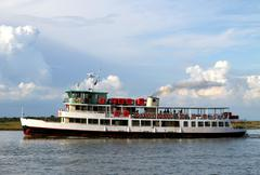 boat ferry for transporting passengers and tourists - stock photo