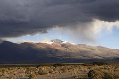 Snow falling from low clouds in the semidesert highplane puna, 4000 m, provin Stock Photos