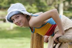 Smiling girl with blue hat, 12 years old Stock Photos