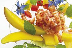 Crab meat salad with mango, borage flowers, diced red capsicum and lemon balm Stock Photos