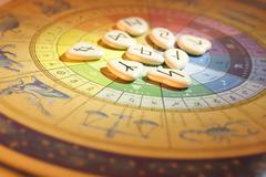 rune stones on tarot board - stock photo