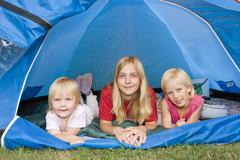 Three sisters, 5 years, 13 and 7 years old, in tent Stock Photos