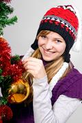 Happy girl decorate the christmas tree Stock Photos
