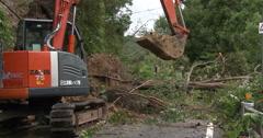 4K / HD Clearing Landslide Debris From Blocked Road - stock footage