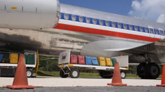 Jet liner travel baggage in carts Stock Footage