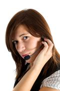 friendly customer service agent smiling during telephone conversation - stock photo
