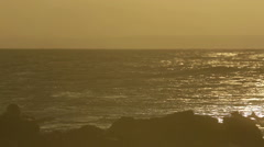 Surfer swiming in the sea under the setting sun Stock Footage