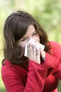 Pretty woman sneeze. allergy season Stock Photos