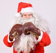 Angry Santa Claus with boxing glove Stock Photos