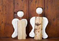 two angels handmade of wood - idea for handicraft or hobby - stock photo