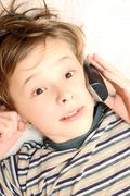 teen boy talking on cell phone - stock photo