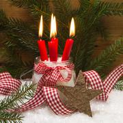 square christmas card decorated with four red burning candles, wooden star, s - stock photo