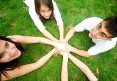 group of friends joining hands. unity, teamwork concept - stock photo