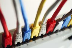 Stock Photo of colored network cables in a hub top view