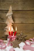 Advent: four red burning candles with christmas decoration  ribbons, wooden s Kuvituskuvat