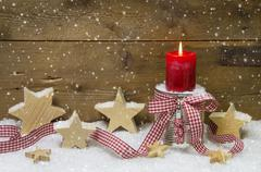 traditional country style decoration in red for christmas with wooden stars, - stock photo
