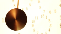 Measuring time. A swinging pendulum. Stock Footage