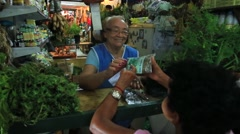 Woman selling natural medicines at the famous Mercado Municipal in Manaus Stock Footage