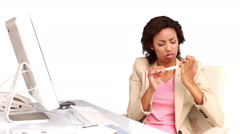 Businesswoman filing her nails at her desk Stock Footage