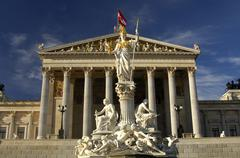 Parliament building and statue of teh goddess pallas athene, vienna, austria Stock Photos
