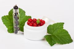 Black and red currant cosmetics Stock Photos