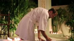 Handsome man preparing bath in the luxury bathroom at night  HD Stock Footage
