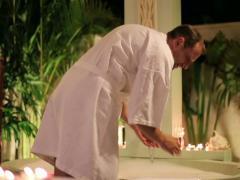 Handsome man preparing bath in the luxury bathroom at night NTSC Stock Footage