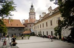 Courtyard of the castle with tower, cesky krumlov, south bohemia, czech repub Stock Photos