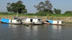 Brazil Amazon backwater near Santarem three boats and canoe on bank s Stock Footage