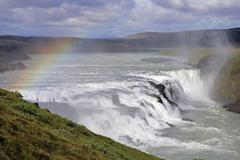 Gullfoss-waterfall at the hvita-river in iceland with rainbow in evening ligh Stock Photos