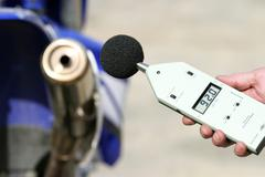 Loudness measurement at a motorcycle exhaust Stock Photos