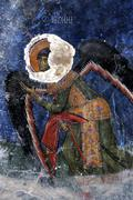 Art theft byzantine wall painting archangel michael in monastery antifonitis  Stock Photos