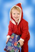 a little boy in the guise of santa claus - stock photo