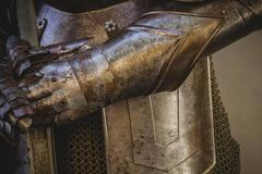 Metal gloves, medieval armor made of wrought iron Stock Photos